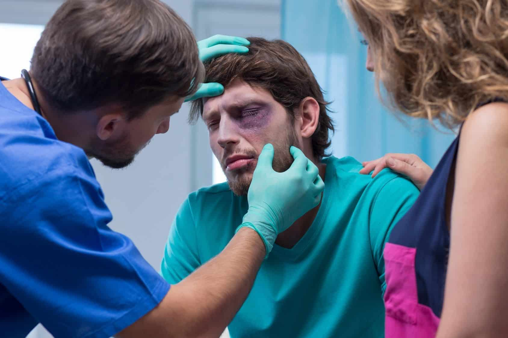 Beaten man with black eye in emergency room